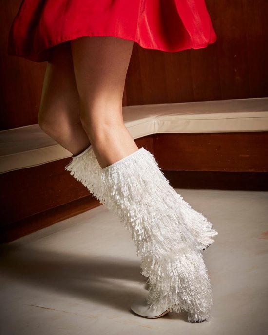 Fringe white boot